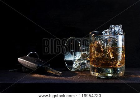 Whiskey Glasses With Ice And Car Keys On Dark Wood, Concept  Drinking And Driving