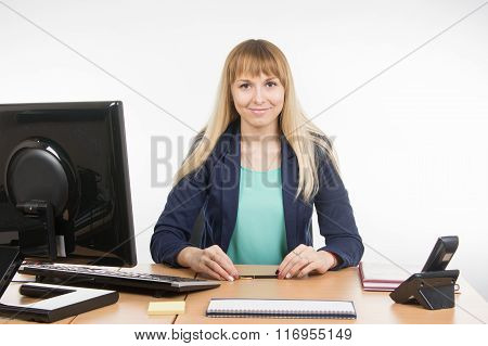 Secretary Sitting Behind A Desk