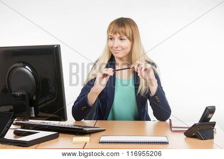 Secretary Girl Looks In The Computer Monitor For Office Table