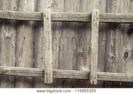 wooden ladder on the wall