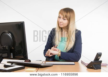 Business Woman Checks The Time On A Computer With A Wristwatch