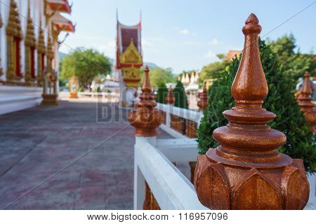 Ornate fence of Thai temple, close-up