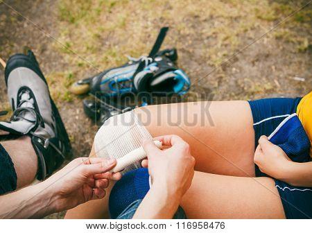Woman Skater With Injured Leg Knee