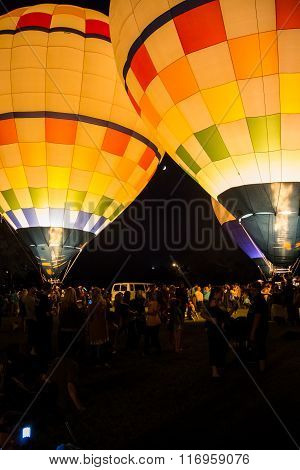 Hot Air Balloon Glow With Crowd