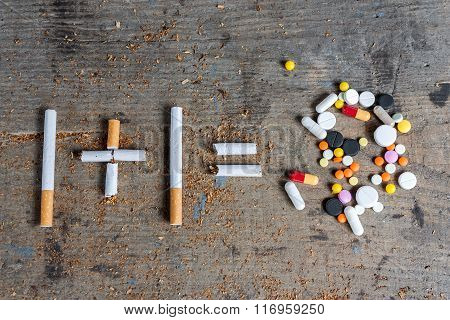 Cigarettes and pills on a wooden surface