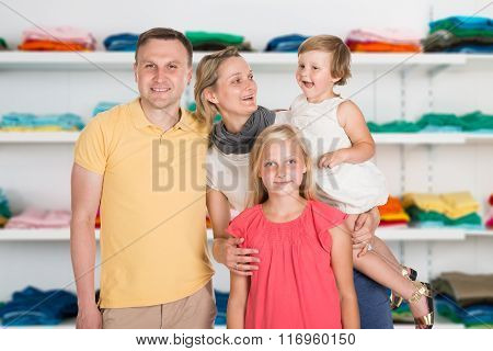 Happy Family Standing At Clothing Store