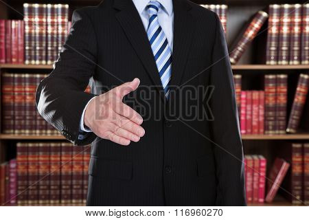 Close-up Of Businessman Offering Handshake