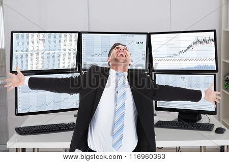 Broker Laughing While Standing With Arms Outstretched