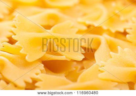Texture Background Of Raw Italian Pasta Farfalle Made Of Wheat Flour.