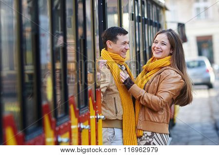 Happy Loving Couple Posing Near A Tram In The City Lviv