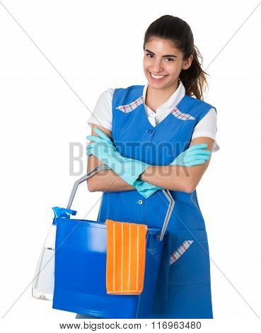 Confident Female Worker Carrying Bucket On White Background
