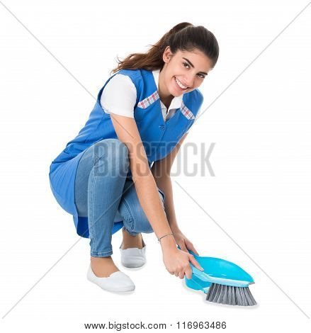 Cleaner Sweeping With Small Broom On White Background