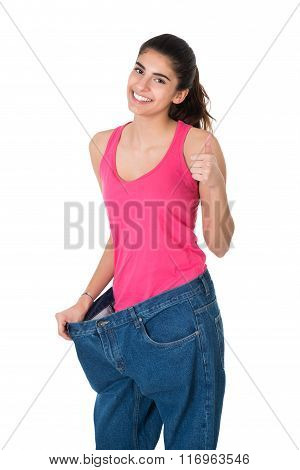 Woman Gesturing Thumbs Up While Showing Her Old Jeans