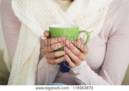 Midsection Of Woman Holding Tee Mug