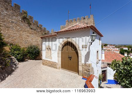 Obidos, Portugal. The medieval Mourisca House. Obidos is a medieval town still inside castle walls, and very popular among tourists.