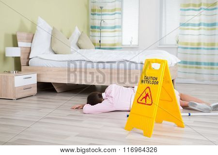 Female Housekeeper Unconscious Near Wet Floor Sign