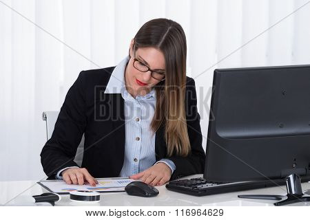 Businesswoman Analyzing Financial Report
