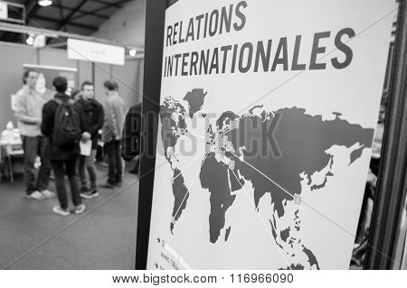 STRASBOURG FRANCE - FEB 4 2016: Children and teens of all ages attending annual Education Fair to choose career path and receive vocational counseling - International relations stand