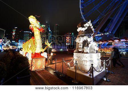 HONG KONG - JANUARY 25, 2016: area around Ferris Wheel in Hong Kong at night. The Hong Kong Observation Wheel is located in Central, Hong Kong.