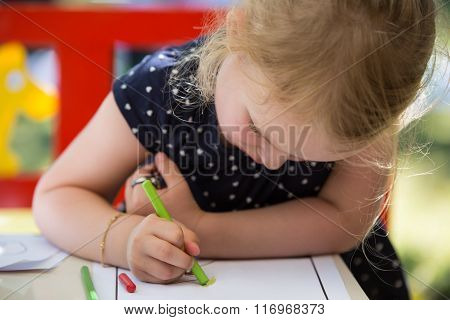 Blond girl coloring