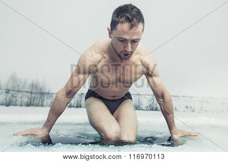 Man going to swim in the ice hole