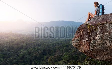 Lady hiker relaxing on top of a mountain