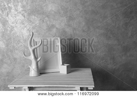 Home decor on table on grey wall background