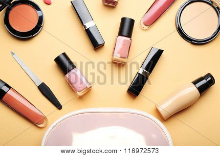 Set of decorative cosmetics on light color background