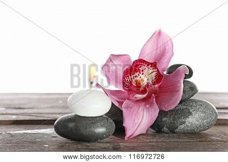 Spa still life with beautiful flower and candle isolated on white