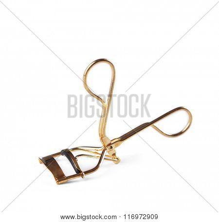 Golden eyelash curler, isolated on white