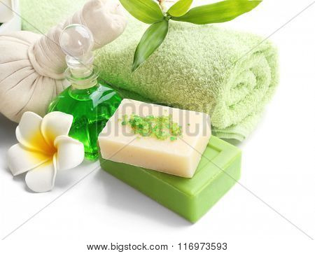 Spa set with exotic flower on white background, close up