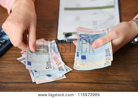 Woman working on financial report at the office, close-up
