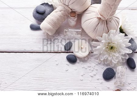 Spa composition and treatments on light wooden background, close-up