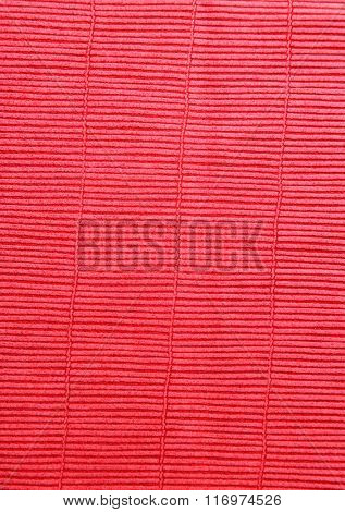 Red cloth texture with uneven surface