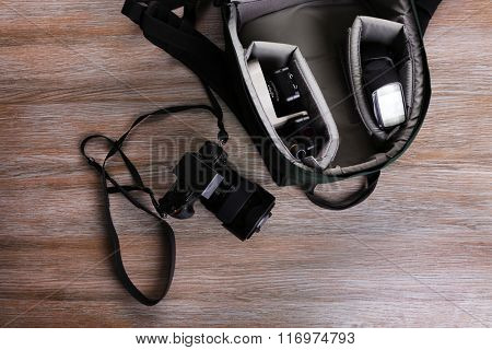 Photographer's equipment on a light wooden background