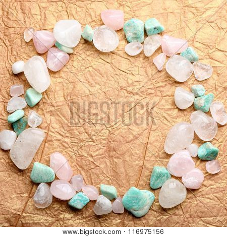 Semiprecious stones on craft paper background