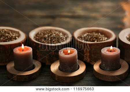 Burning wooden candles with sea salt, closeup