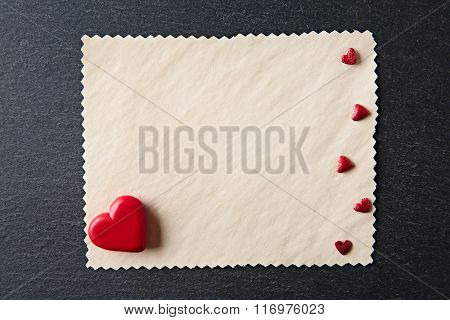 Blank present Valentine card on black textured background