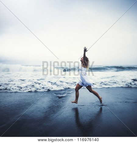 Young Woman with Arms Raised by the Beach Concept