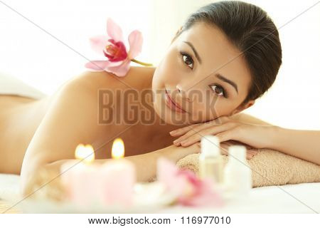 Spa concept. Young pretty woman relaxing on white background, close up