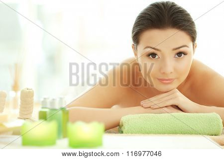 Spa concept. Young pretty woman relaxing, close up