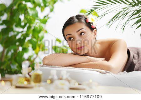 Beautiful young woman relaxing at beauty spa