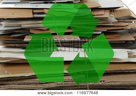 Big stack of papers and recycle sign