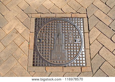 Manhole cover featuring the Martini Tower