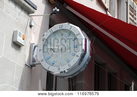 Wall clock in the shape of a watch in Zurich, Switzerland