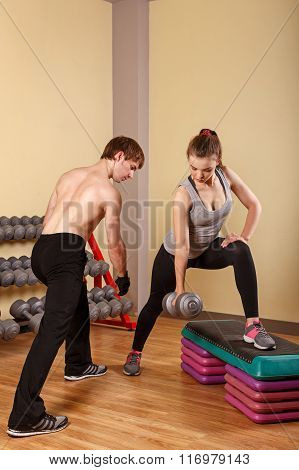 Coach Explains Girl Exercise With Dumbbells.