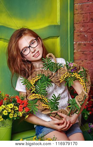 Teen Girl With Glasses Holding Bouquet Of Flowers.