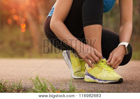 Woman Tying Sport Shoes Ready For Run