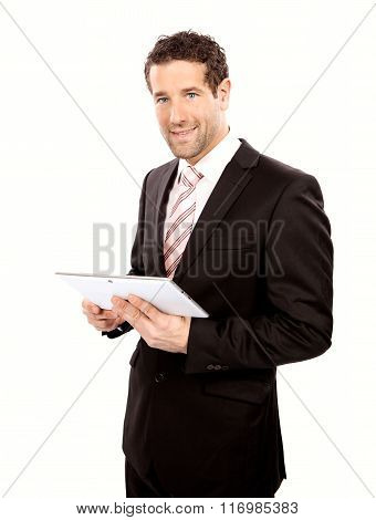 Smiling businessman with tablet pc