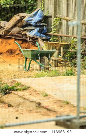 Construction Site With Green Barrow